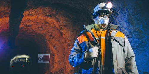 mine worker with face mask and gloves