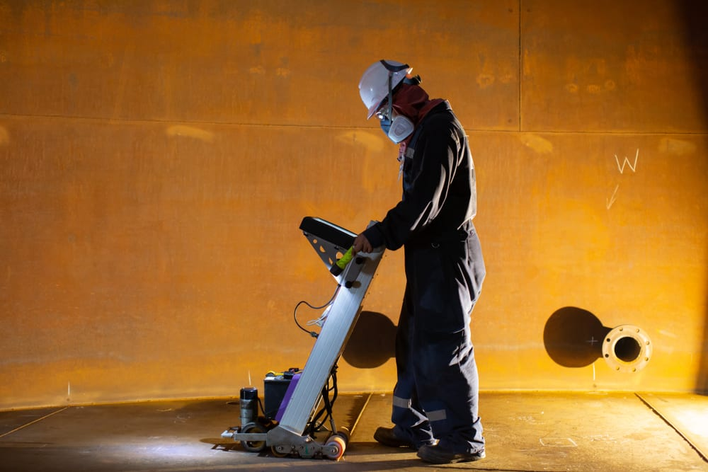 man using a piece of industrial equipment