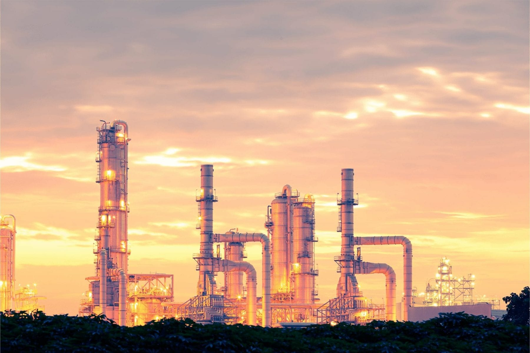 oil production facility at sunset